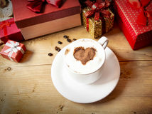 Heart Shape Cappuccino Cup with Whipped Cream and Wrapped Gifts Stock Image