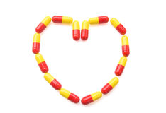 Heart shape capsules Stock Photo