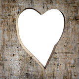 Heart shape carved into a plank Stock Photo