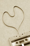 Heart shape of cassette tape sepia color. Stock Photo