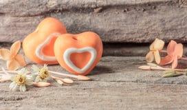 Heart shape ceramic on wood background. Stock Image