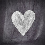 Heart shape chalk drawing on chalkboard blackboard. Black stock images
