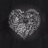 Heart shape chalk drawing on chalkboard blackboard.Floral heart. Heart made of flowers.Doodle Heart stock photography