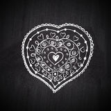 Heart shape chalk drawing on chalkboard blackboard. Love stock images