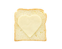 Heart shape cheese on bread Royalty Free Stock Image