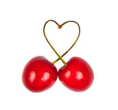 Heart shape from cherries with green leaves Royalty Free Stock Photos