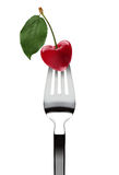 Heart shape cherry upon fork Royalty Free Stock Photos