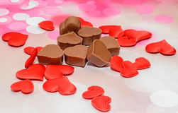 Heart shape chocolate with red hearts, Valentines Day sweets, pink bokeh background Royalty Free Stock Photo
