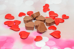 Heart shape chocolate with red hearts, Valentines Day sweets, pink bokeh background Stock Photography