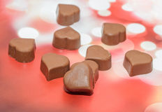 Heart shape chocolate with red hearts, Valentines Day sweets, red bokeh background Stock Photo