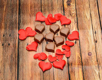 Heart shape chocolate with red hearts, Valentines Day sweets, wood background Stock Photography