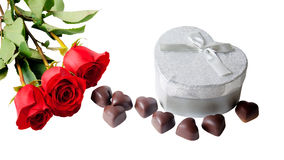 Heart shape chocolate, red roses and gift box Stock Images