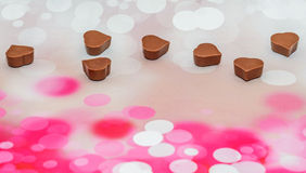 Heart shape chocolate, Valentines Day sweets, pink bokeh background Stock Images