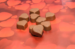 Heart shape chocolate, Valentines Day sweets, red hearts background Stock Photography