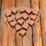 Heart shape chocolate, Valentines Day sweets, wood background Royalty Free Stock Image