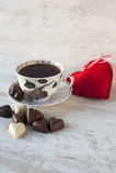 Heart shape chocolates. Valentine's day still-life. Valentine's day still-life. Cup of tea with heart shaped chocolates on gray wooden background Royalty Free Stock Photos