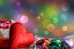 Heart shape chocolates on wood table Stock Photos