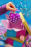 Heart shape christmas bauble in child hand Royalty Free Stock Image