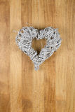 Heart Shape Christmas Door White Wreath on Sapele Wood Backgroun Stock Photos