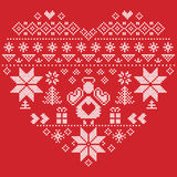 Heart shape Christmas  pattern with angel on red background. Heart Shape Scandinavian Printed Textile  style and inspired by  Norwegian Christmas and festive Stock Image