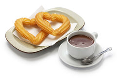 Heart shape churros and hot chocolate on white background Stock Image