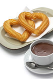 Heart shape churros and hot chocolate on white background Stock Images