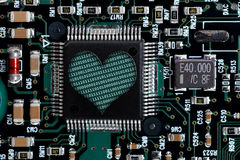 Heart shape in circuit board. Binary filled heart shape in electronic circuit board Royalty Free Stock Photography