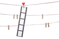 Heart  shape clip on a  twine, hanging Negatives, love movie Royalty Free Stock Photography