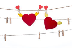 Heart  shape clip on a  twine , hanging wings heart Royalty Free Stock Image