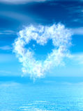 Heart shape cloud over water surface. Royalty Free Stock Photos