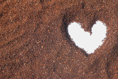 Heart shape on cocoa powder Royalty Free Stock Images