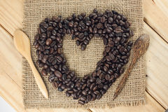 Heart shape coffee beams. Heart shape coffee beams on sackcloth Royalty Free Stock Images