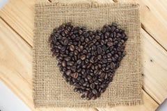 Heart shape coffee beams. Heart shape coffee beams on sackcloth Royalty Free Stock Photo