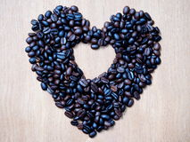 Heart shape from coffee bean on wood texture Stock Photo