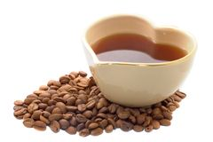 Heart shape coffee cup. With coffee beans isolated over white Stock Photography