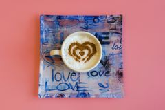 Heart Shape Coffee Cup Concept isolated on pink background. love cup , heart drawing on latte art coffee.  stock images