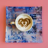 Heart Shape Coffee Cup Concept isolated on pink background. love cup , heart drawing on latte art coffee. square.  royalty free stock images
