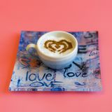 Heart Shape Coffee Cup Concept isolated on pink background. love cup , heart drawing on latte art coffee. square.  royalty free stock image