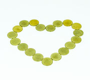 Heart shape from coins Stock Image