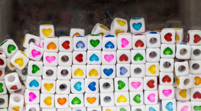 Heart shape on colorful cubic beads object Royalty Free Stock Image