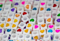 Heart shape on colorful cubic beads object Stock Images