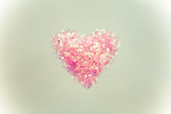 Heart shape on colour background,vintage style Royalty Free Stock Photography