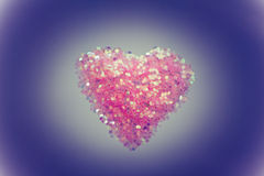 Heart shape on colour background,vintage style Royalty Free Stock Photo