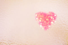 Heart shape on colour background,vintage style Stock Images