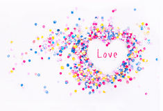 Heart shape in confetti with sample text. Love stock image