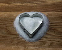 Heart shape cookie mold on a wood and sugar Stock Photography