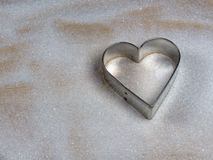 Heart shape cookie mold on wood and sugar Stock Photos