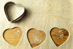 Heart shape cookie preparation Royalty Free Stock Images