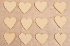 Heart shape cookies with dough Stock Images