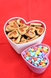 Heart shape cookies. And love candies in bowl stock photo